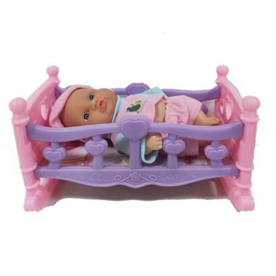 Rózsaszín ruhás baba lil-rózsaszín kisággyal 25 cm